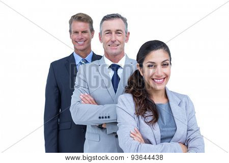 Happy business team standing in a line against a white screen