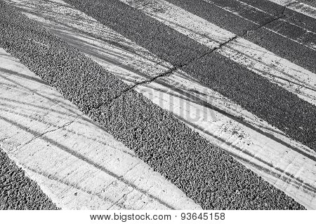 Tire Tracks Over Pedestrian Crossing Road Marking