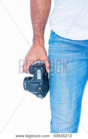 A man holding photo camera on white background