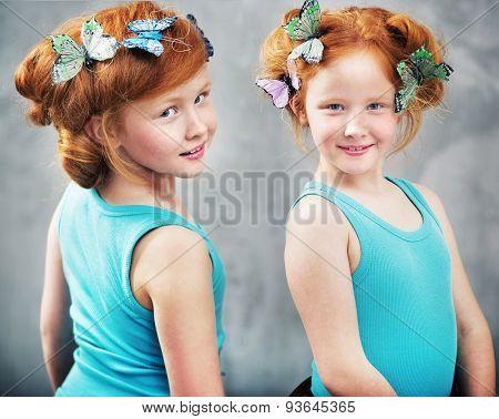Portrait of happy twins smiling