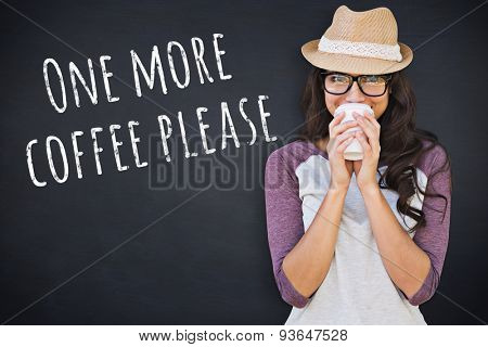 Brunette with disposable cup against black background