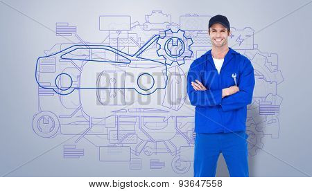 Confident mechanic holding wheel wrenches against grey vignette