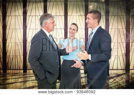 Business people standing and talking against window overlooking city