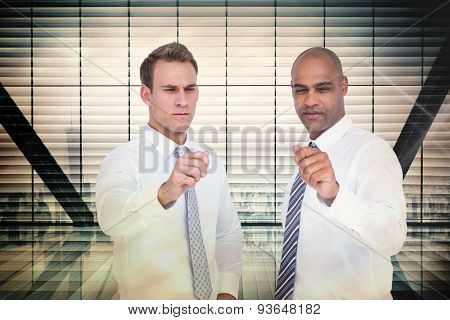 Businessmen pointing something with their hands against window overlooking city