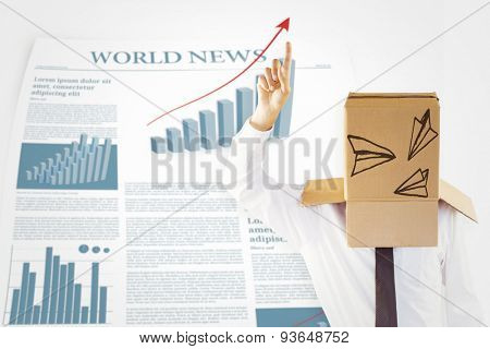 Anonymous businessman with hand pointing up against world news sheet with statistics