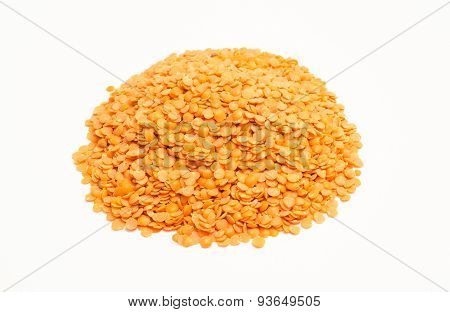 The Seeds Of Red Lentils On The White Background