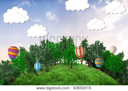 Sphere covered with forest against hot air balloons hanging from clouds