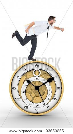 Geeky young businessman running late against pretty looking clock