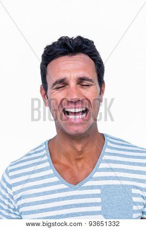 Sad man is crying on white background