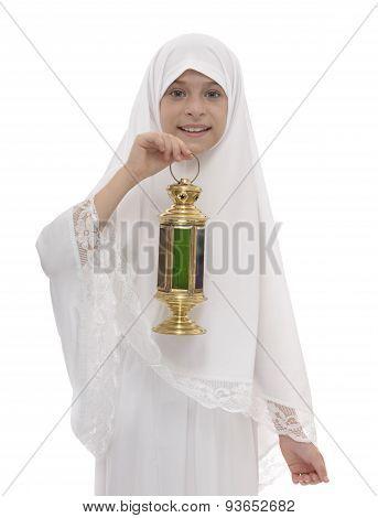 Happy Muslim Girl Celebrating Ramadan Holding A Lantern