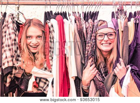 Young Hipster Women At Clothes Flea Market - Best Friends Sharing Fun Time Shopping In The City