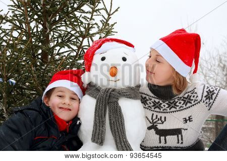 Mother And Son Playing Snowman.