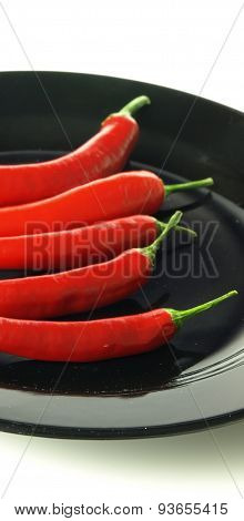 Chili Peppers On Black Plate