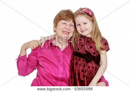Happy grandmother hugs her favourite grandchild , close-up