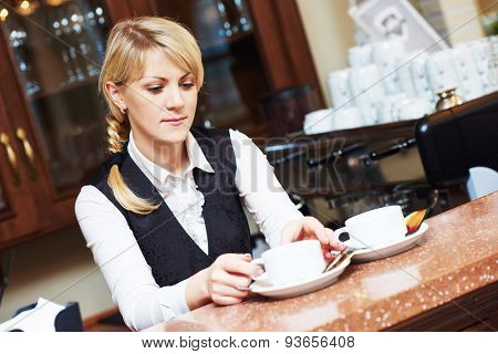 barista woman serving tea at the restaurant bar desk