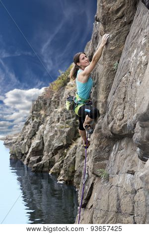 Female climber and rocky river