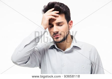 Casual man having headache isolated on a white background