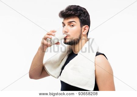 Handsome man drinking milk isolated on a white background. Looking at camera
