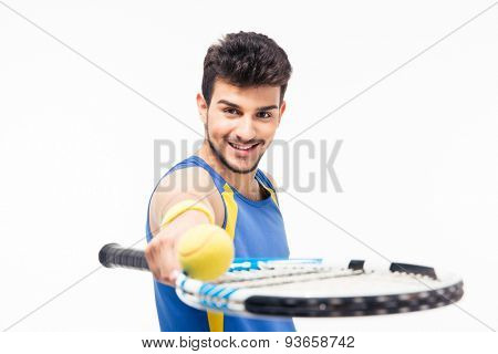 Smiling sports man holding tennis racket and ball isolated on a white background. Looking at camera