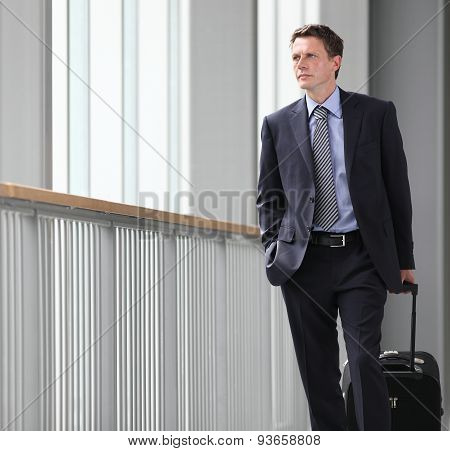 businessmanwalking with trolley, business travel concept