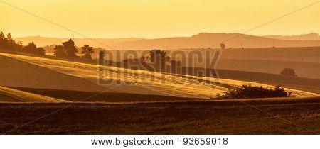 Panorama of Moravian rolling landscape on sunset in yellow colors. Moravia, Czech Republic