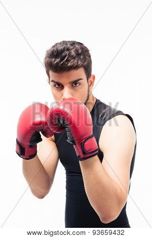 Portrait of a male boxer with red gloves isolated on a white background. Looking at camera