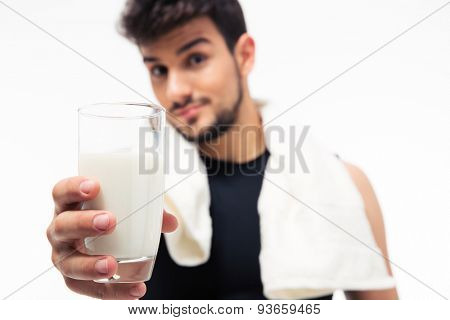 Man holding glass with milk isolated on a white background. Focus on glass