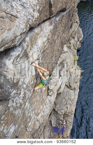 Group of female rock climbers makes and ascent on the rocky wall