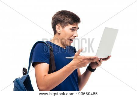 Male student with disgusted emotion holding laptop isolated on a white background