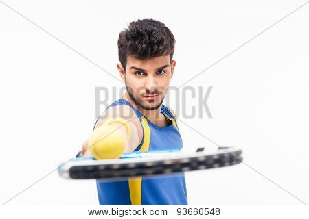 Handsome man holding tennis racket with ball isolated on a white background. Looking at camera