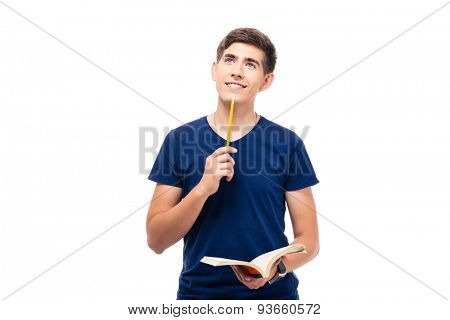 Thoughtful male student holding book and looking up isolated on a white background
