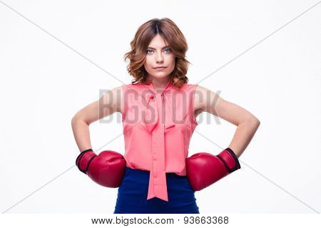 Beautiful elegant woman with boxing gloves isolated on a white background. Looking at camera
