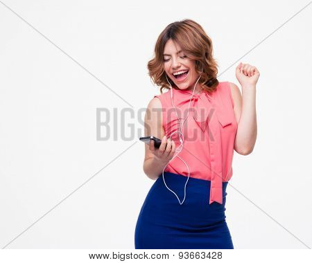 Laughing woman listening music in headphones isolated on a white background