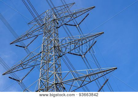 High Voltage Tower With Blue Sky Background.