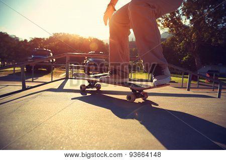 young woman skateboarding at skatepark,vintage effect