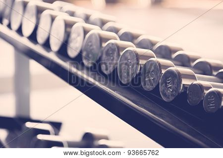 Sports dumbbells  ( Filtered image processed vintage effect. )