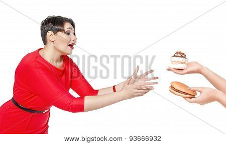 Beautiful Plus Size Woman Seduced With Hamburger And Pastry