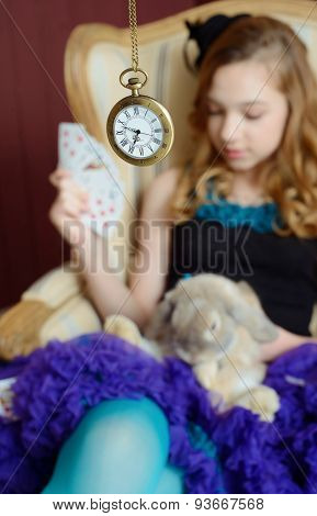 Young girl at the image of Alice in Wonderland