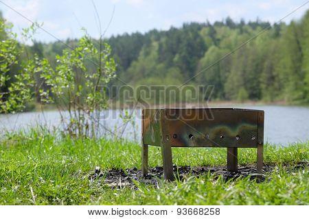 brazier on a lake bank