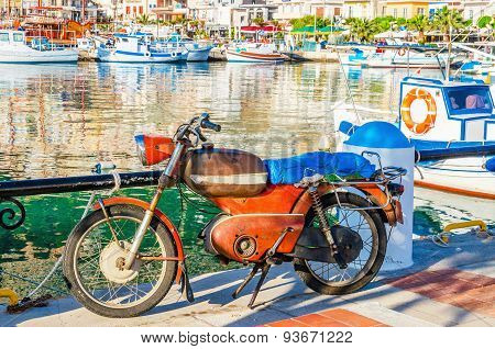 Classic old motor in small Greek port, Greece