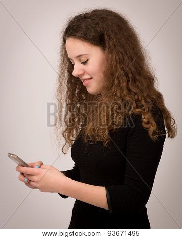 Teenage Ginger Girl Texting To Her Friends