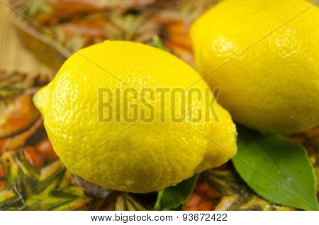 Two Lemons On A Decorated Table