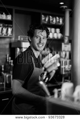 PARIS - SEPTEMBER 09: Starbucks cafe barman on September 09, 2014 in Paris, France. Starbucks is the largest coffeehouse company in the world, with more then 23000 stores