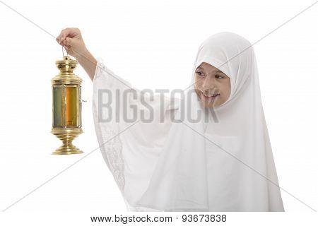 Happy Muslim Girl Celebrating Ramadan With Festive Lantern