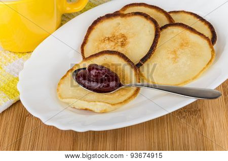 Pancakes With Jam In Spoon On Dish And Milk