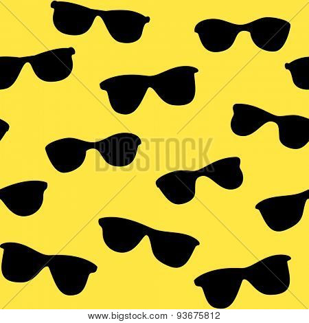 Yellow seamless background with black sunglasses