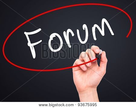 Man Hand writing Forum black marker on visual screen.