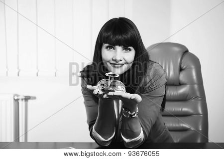 Young girl sitting in the office.