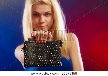 Elegant Woman Holds Black Handbag