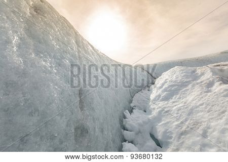 Glacial cave in vatnajokull in Iceland with sun